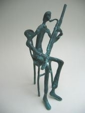 Fagottist op Stoel - Brons