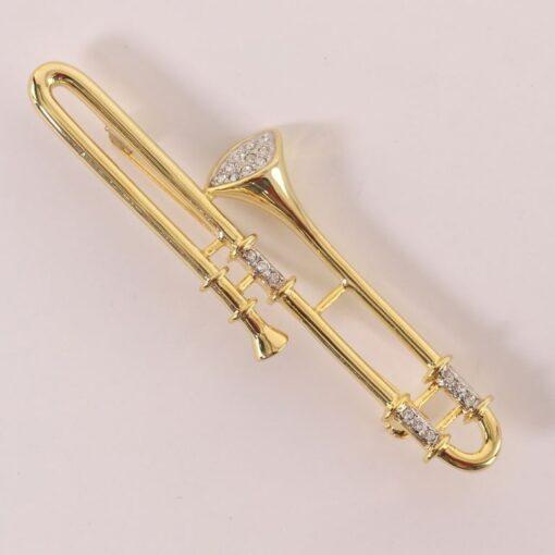 Broche: Trombone 90 Gl + Strass